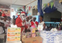The Executive Director of Santa-Kobby Kids Charity Foundation,Mr. Kobina Kum Presenting the Items to the Officer In-Charge of Egyaam Children's Home