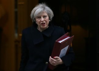 British Prime Minister Theresa May leaves 10 Downing Street for Prime Minister's questions at the House of parliament in London, Britain, Feb. 8, 2017. The British House of Commons on Wednesday night passed the Brexit Bill which gives the British government the power to begin the formal process of Britain leaving the European Union. (Xinhua/Tim Ireland)