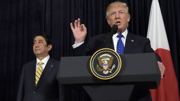 US President Donald Trump speaks alongside Japanese Prime Minister Shinzo Abe following North Korea's missile launch on Sunday, 11 February 2017