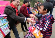 A party member volunteer gave sports equipment to a student of Miao ethnic group at Daxin Village, Liuzhou city of Guangxi Zhuang Autonomous Region, Jan. 6. A total of 72 students of the Miao, Yao and other ethnic groups received books, stationery and sports equipment donated by the organization department of Liuzhou and other 28 organizations. Meanwhile, a total of 290,000 yuan ($42,000) will donated by them to subsidize over 300 impoverished students for three consecutive years. (Photo by Pang Geping, Long Zhilin from People's Daily)