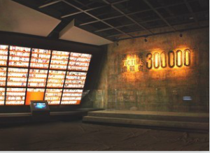 """Photo taken shows the exhibition """"A Human Holocaust: Historical Facts of the Nanjing Massacre"""" held by Memorial Hall of the Victims in Nanjing Massacre by Japanese Invaders. The right side of the photo shows words written in Chinese, English and Japanese saying """"victims 300,000"""". (Photo: official website of Memorial Hall of the Victims in Nanjing Massacre by Japanese Invaders)"""