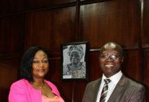 Ms Otiko Djaba receiving the proposal from Professor Mark Adom-Asamoah