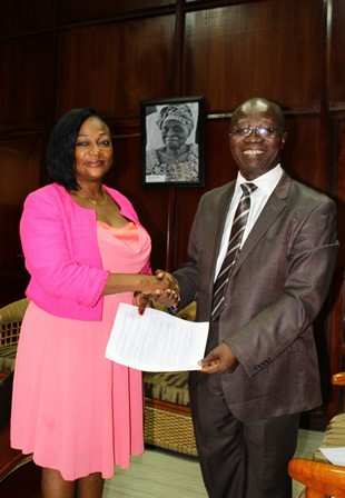 Ms Otiko Djaba receiving the proposal from Professor Mark Adom-Asamoah