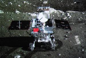 "Robotic lander of Chang'e-3 takes photo of the lunar rover ""Jade Rabbit"". (File photo)"