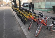 Shared bikes are lined up outside a subway entrance in CBD in Beijing. (Photo by Qiang Wei from People's Daily)