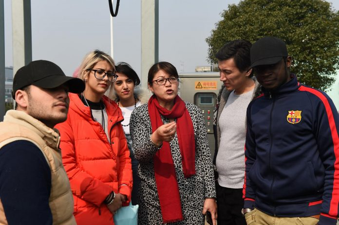 Overseas students from Russia, Iran and Jordan of Yiwu Industrial &Commercial College visited Yiwu sewage disposal center to learn about the process and technology of sewage treatment on Feb. 27, 2017. (Photo by People's Daily)
