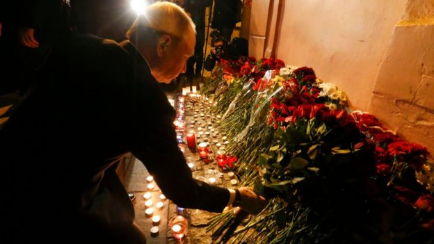 Russian president Vladimir Putin puts flowers down outside Tekhnologicheskiy Institut metro station in St. Petersburg, Russia, April 3, 2017