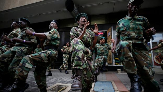 Supporters of the African National Congress (ANC) outside the ruling party's headquarters in Johannesburg