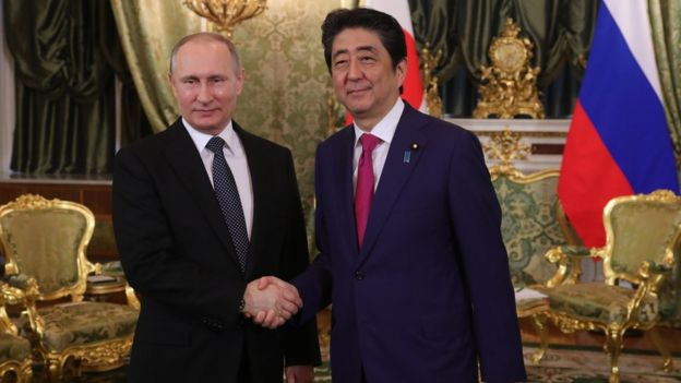 Russian President Vladimir Putin (L) shakes hands with Japanese Prime Minister Shinzo Abe (R) during their meeting at the Kremlin in Moscow, Russia, 27 April 2017