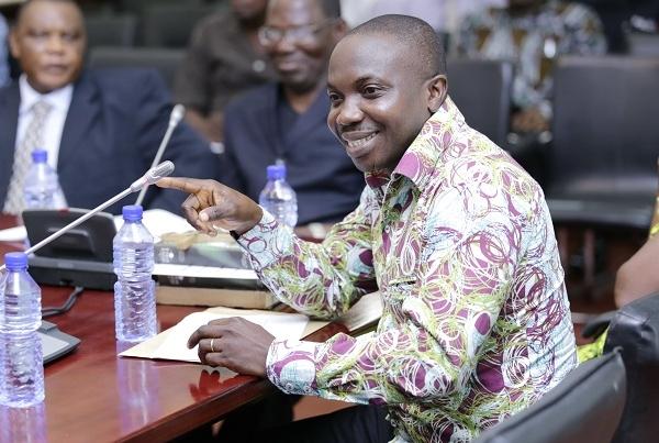 The auctioneer, Alex Agyei