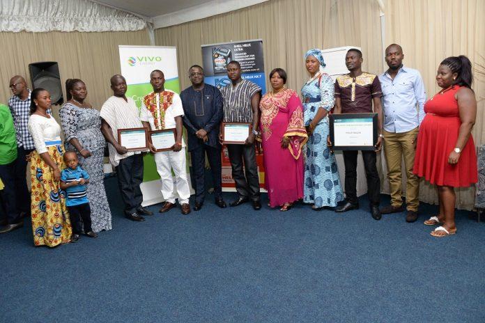 Managing Director of Vivo Energy Ghana (centre), Mr. Ebenezer Faulkner w...