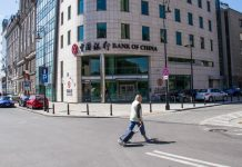 Photo taken shows a passerby walking in front of the Poland branch of the Bank of China in Warsaw, the country's capital city. Officially started operation on June 6, 2012, the bank has had full access to the financial market of Poland, providing high-quality financial services for Chinese and Polish clients from the industrial, commercial and financial sectors as well as for individual customers. Its services include deposit, loan, remittance of local and foreign currencies, foreign exchange transactions, trade finance, and guarantee, etc. The branch is the first Chinese bank officially operating in Poland. (Photo by Xinhua News Agency)
