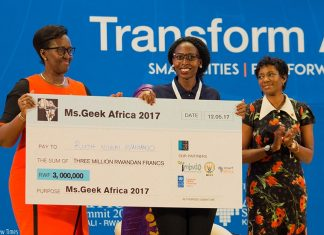 First Lady Jeannette Kagame (L) presents Miss Geek Africa 2017 Waiganjo with a dummy cheque yesterday. Timothy Kisambira.