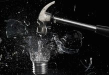 smashing a light bulb with a hammer