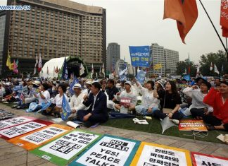 Demonstrators attend a protest against the deployment of THAAD in Seoul, South Korea, on June 24, 2017. Thousands of South Korean protestors against the deployment of the U.S. Terminal High Altitude Area Defense (THAAD) in their homeland took to the streets in central Seoul to demand the reversal of the installation decision. (Xinhua/Yao Qilin)