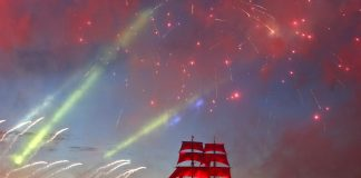A brig with scarlet sails floats on the Neva River as fireworks explode during the Scarlet Sails festivities marking school graduation in St. Petersburg, Russia, June 24, 2017. (Xinhua/Irina Motina)