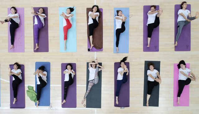 Yoga fans practise yoga during an event marking the International Yoga Day, which falls on June 21 every year, in Tengzhou City, east China's Shandong Province, June 20, 2017. (Xinhua/Song Haicun)