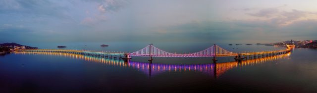 Combined aerial photo taken on June 11, 2017 shows the Xinghaiwan Bridge in Dalian, northeast China's Liaoning Province. Dalian is one of the host cities of the Summer Davos meeting.   (Xinhua/Li Xin)
