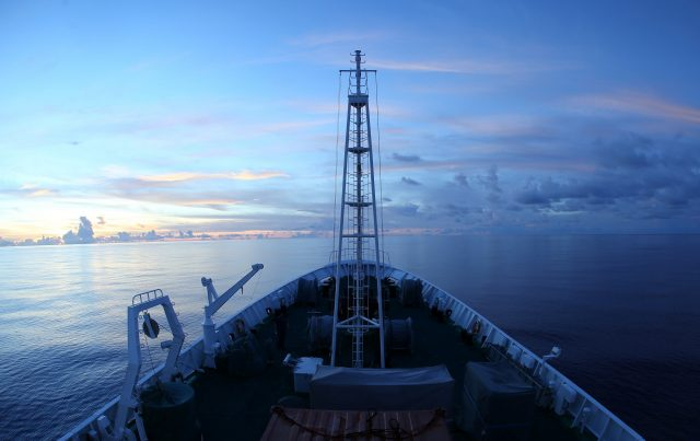 Photo taken on June 18, 2017 shows the sunset scenery in the west Pacific seen from Xiangyanghong 09, mothership of China's manned submersible Jiaolong.  (Xinhua/Liu Shiping)