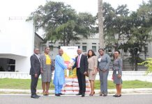 Mr. Saddique (3rd from left) receiving the items from Mr. Ifeanyi Njoku and the Access Bank team