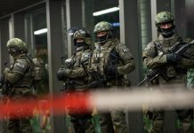 German special police stand in front of the Munich, southern Germany, main train station on 31, 2015.(AP File Photo).