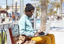 Man working while traveling