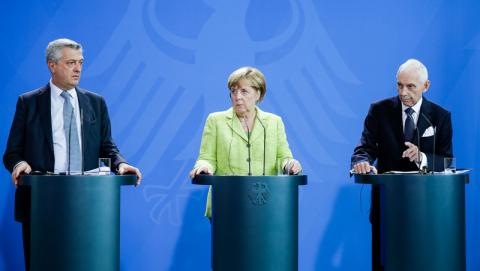 From left: UN High Commissioner for Refugees Filippo Grandi, German Chancellor Angela Merkel, and UN Migration Agency (IOM) Director General William Lacy Swing meeting in Berlin on 11 August 2017, to discuss international migration. Photo: Federal Government of Germany / Jesco Denzel 2017
