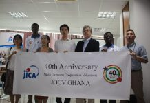 Chief Representative of JICA Ghana Mr. Hoshi Hirofumi (in suit) with other JICA and JOCV officials launching the JOCV 40th Anniversary in Ghana