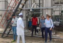 Mr Rockson Bukari (in white), the Upper East Regional Minister, conducting the TV crew around the Pwalugu Tomato Factory