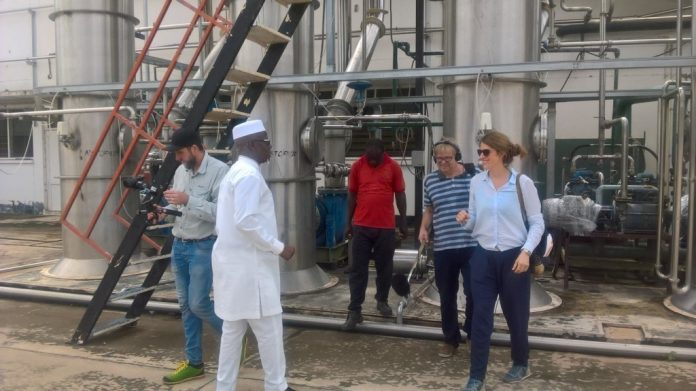 Mr Rockson Bukari (in white), the Upper East Regional Minister, conducting the TV crew around the Pwalugu Tomato Factory