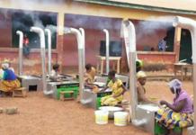 """Kenyase Number Three women roasting gari with """"Gari Elephant"""""""