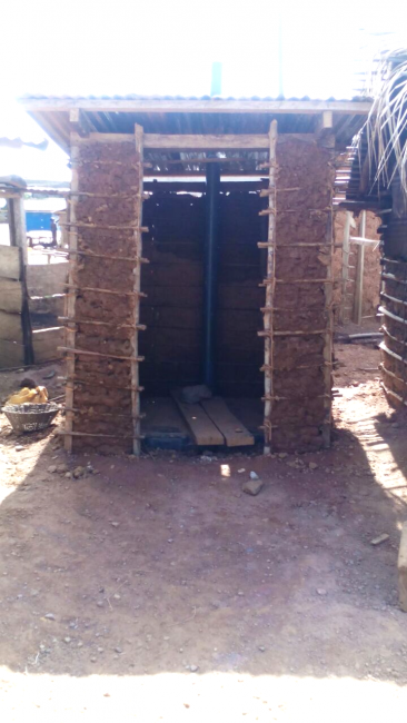 A household latrine completed with the plastic latrine slab