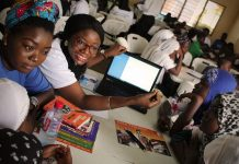 Volunteers train students on using digital literacy tools