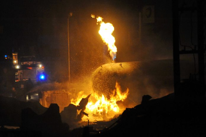 An explosion occurs at a fuel station in north Accra, capital of Ghana, Oct. 7, 2017. The explosion happening late Saturday left at least two people dead. (Xinhua/Shi Song) (yk)