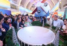 "Visitors get an introduction to China's 500-meter Aperture Spherical Radio Telescope (FAST), nicknamed ""Tianyan"", at the exhibition of China's progress over the past five years in Beijing, Oct. 1, 2017. (Photo by People's Daily Online)"