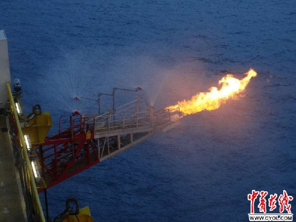 A flame emerges on the Blue Whale 1 drilling platform in the Shenhu area of the South China Sea, marking China's successful exploitation of natural gas from the natural gas hydrate at the seabed 1,266 meters under the sea.  (Photo by China Youth Online)