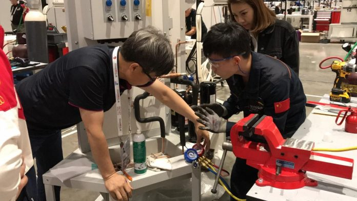 Chinese representatives are competing at the 44th WorldSkills in Abu Dhabi, UAE. (Photo by Han Xiaoming from People's Daily)