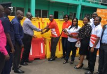 GOIL Zonal Manager presenting the equipment to an official of the Assembly