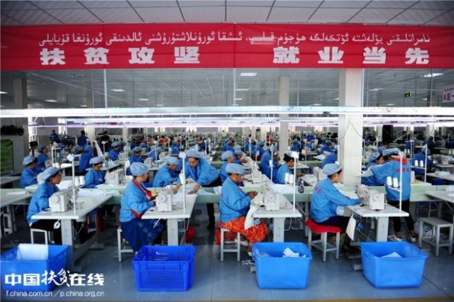 Uyghur workers make clothes at a clothing factory in an entrepreneurship & employment park in Wuqia Township, Kuche County, Xinjiang Uygur Autonomous Region, September 27, 2016. The factory has created jobs for 600 households in poverty and surplus rural labor forces. (Photo from the official website of China's poverty alleviation work)