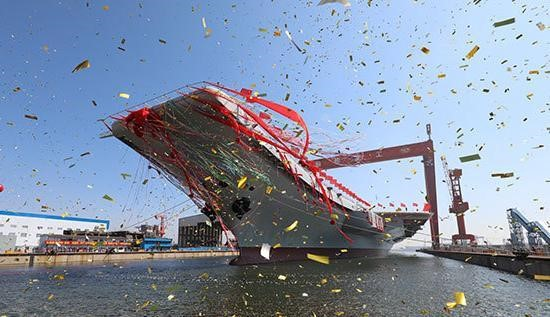 China's first home-built aircraft carrier is transferred from dry dock to the water on April 26, 2017. (Photo by sina.com)