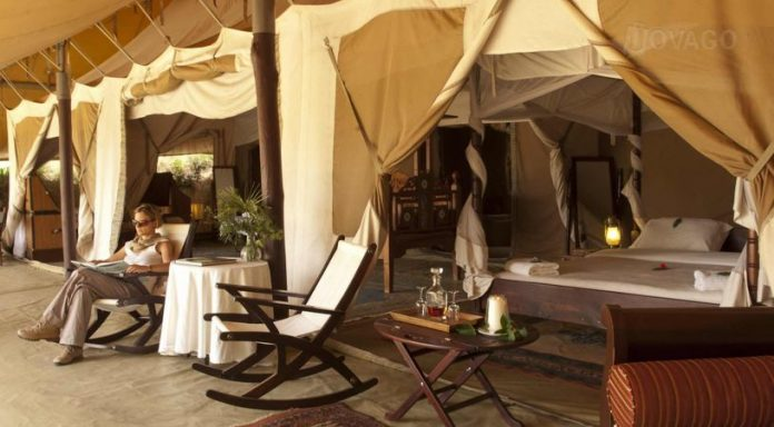 A tourist enjoys her stay at Cottar 1920's Camp-Masai Mara