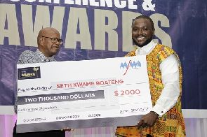 Seth Kwame Boateng [right] receiving the overall West Africa Best Journalist Award.