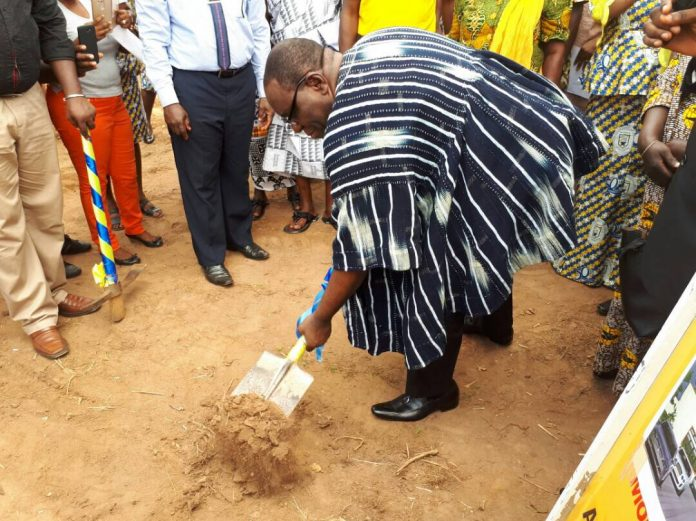 THE HEADMASTER OF NEW JUABEN SENIOR HIGH SCHOOL, MR. FRANK OBENG WILSON BREAKS THE GROUND AT PROJECT SITE