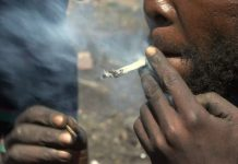 A Liberian youth smoking drug (opium) and this is common across Liberia