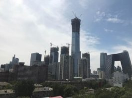 Beijing's skyline shows office buildings and residential buildings in the Central Business District (CBD). (Photo by Wang Yunsong from People's Daily)