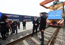 Photo shows the Chinese and Russian operators of a China-Europe freight train who are giving interviews to media. The freight train, loaded with 100 standard containers of small commodities, left Yiwu, Zhejiang province, Jan. 30, 2018. It would travel 10,150 km via Manzhouli, Inner Mongolia Autonomous Region and reach Moscow in about 13 days. (Photo by Gong Xianming from CFP)