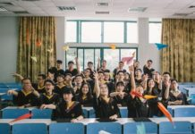 Graduates from Zhejiang University fly paper planes at a classroom, July, 2017. (Photo from People's Daily Online)