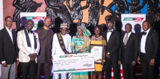 Hamidu Mohammed, the Puma Energy Dealer of the Year flanked by his wife and some members of Puma Energy management-1