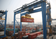 Photo taken on January 17, 2018 shows the busy automated container terminal at Port of Qingdao in east China's Shandong province. (Photo by Zhang Jingang from People's Daily Online)