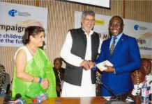 Nobel Peace Prize Laureate, Dr. Kailash Satyarthi presenting a signature token to the Secretary General of the All-Africa Students Union (AASU), Mr. Peter Kwasi Kodjie at the Africa Launch of the 100 Million Campaign